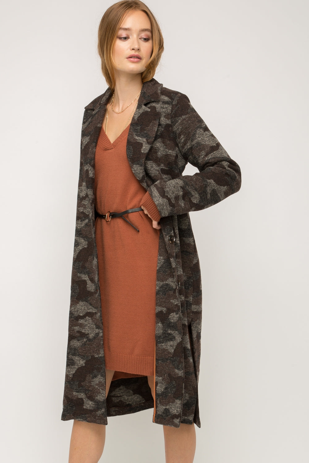 Mystree Camo Long Coat. Camo long coat  Button-front closure Side pockets Side slits detail Fully lined -100% Polyester  -Contrast: 100% Polyester  -Lining: 100% Rayon