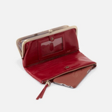 With pockets for planning and plotting, our new Wind wallet can be carried on its own as a clutch or kept in your HOBO Bag for easy access when you need it. Crafted in our signature vintage hide leather that only gets more beautiful over time with use and wear.