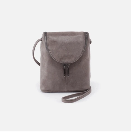 "A best seller & Hobo icon, the Fern crossbody bag is the perfect small leather purse & has stood the test of time since first designed in 1991. Crafted in our signature velvet hide, our softest and most casual leather that only gets more beautiful over time. Old English Brass hardware Zip closure Exterior: Back wall cell pocket - perfect for your smartphone Interior: Back wall zip pocket Fits most cell phones Wanderlust lining Solid leather single strap 26"" Strap Drop 6"" W x 7.5"" H x 2"" D"