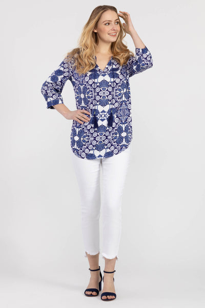 If your wardrobe needs a touch of originality, choose this navy blue mix patterned blouse! Featuring a subtle v-neck, 3/4 sleeves and a trendy neckline tie - this flowy blouse is boho-chic at its finest!