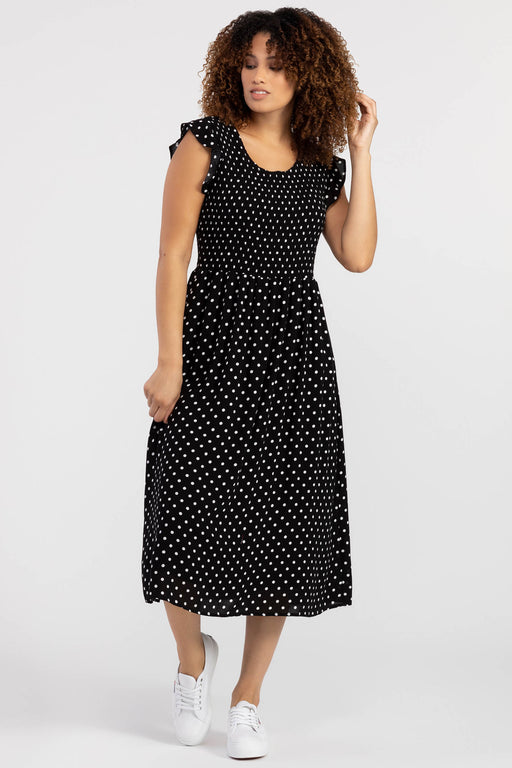 "This season's ""it"" dress is this long, swingy polka dot dress adorned with charming ruffle sleeves. Not only is this effortless smock dress the perfect outfit for the warm days ahead, but it also has pockets; combining style with function."