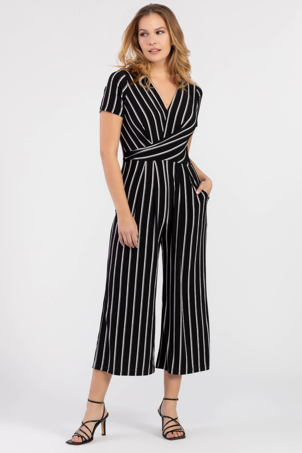 Consider this your 2020 summertime staple! This incredibly soft short sleeve faux-wrap jumpsuit looks fantastic on all sizes, hugging you in all the right places. Features a v-neck cut and slouched wrap gathered details, front pockets, and a concealed back zip, this striped jumpsuit is a versatile piece that's perfect for the office and the weekend!