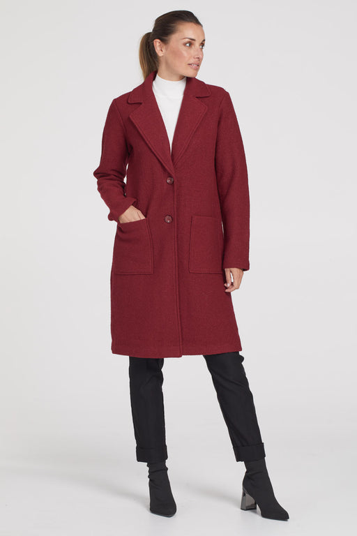 Tribal Boiled Wool Coat. The perfect transitional outerwear piece for fall is definitely this stunning boiled wool overcoat. Its foldover lapel collar can be raised to protect your neck from wind and cold, and a pair of front pockets offer convenience without sacrificing style.