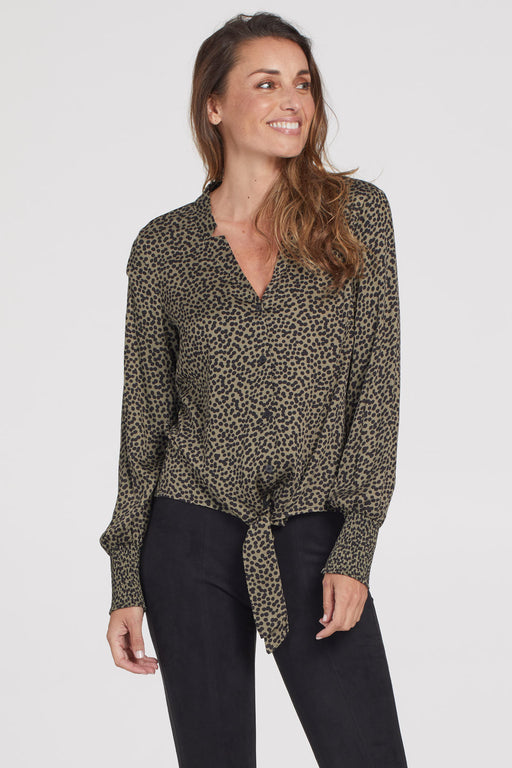 Tribal Blouse With Front Tie. Decorated in a dotted pattern that can be dainty or daring, this feminine blouse features a drapey front tie for added charm. The casual chic design makes going out look effortless, every time.