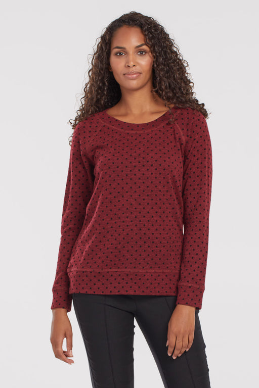 Tribal Raglan Sleeve Top With Flocked Print. Choose cozy without sacrificing style in this lightweight boat neck top, dotted with a flocked velvet pattern. This raglan-sleeve top has visible seam detailing at the cuffs, neckline, and hem and is a super cute textured top layer choice for your fall wardrobe.