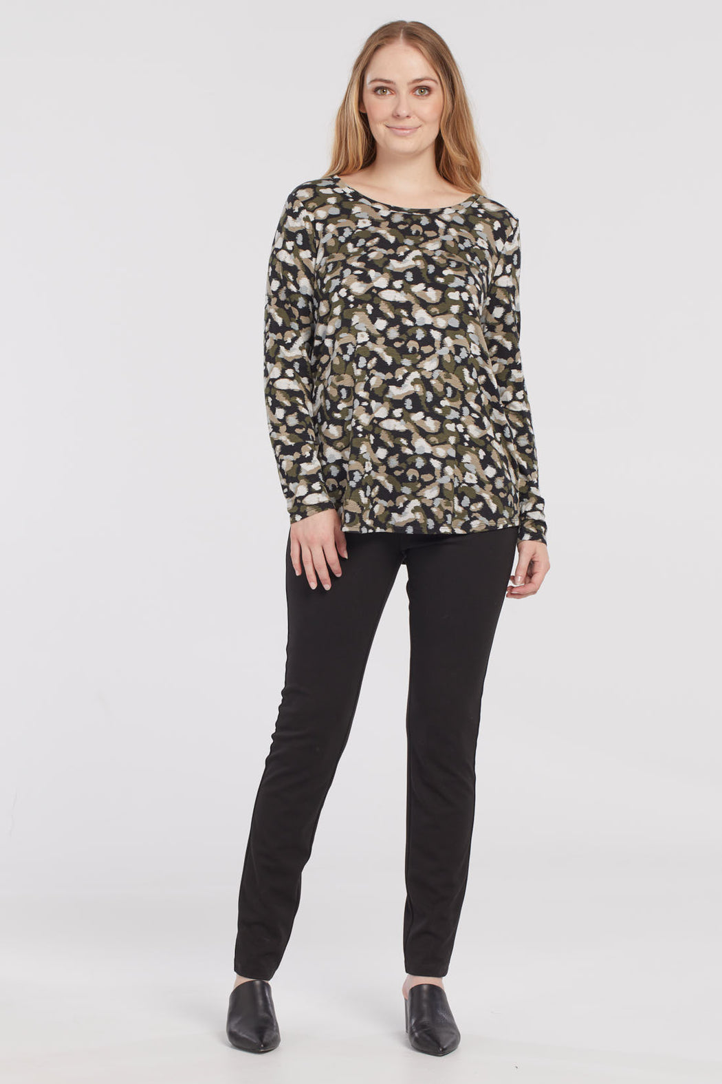 Tribal Long Sleeve With Back Opening. This lightweight top in slub jersey with a soft scoop neck, has all the features to be a superstar in your wardrobe. The layer-friendly fabric, back opening feature, and charming abstract pattern make it just as suitable for the office as it is for a night out.