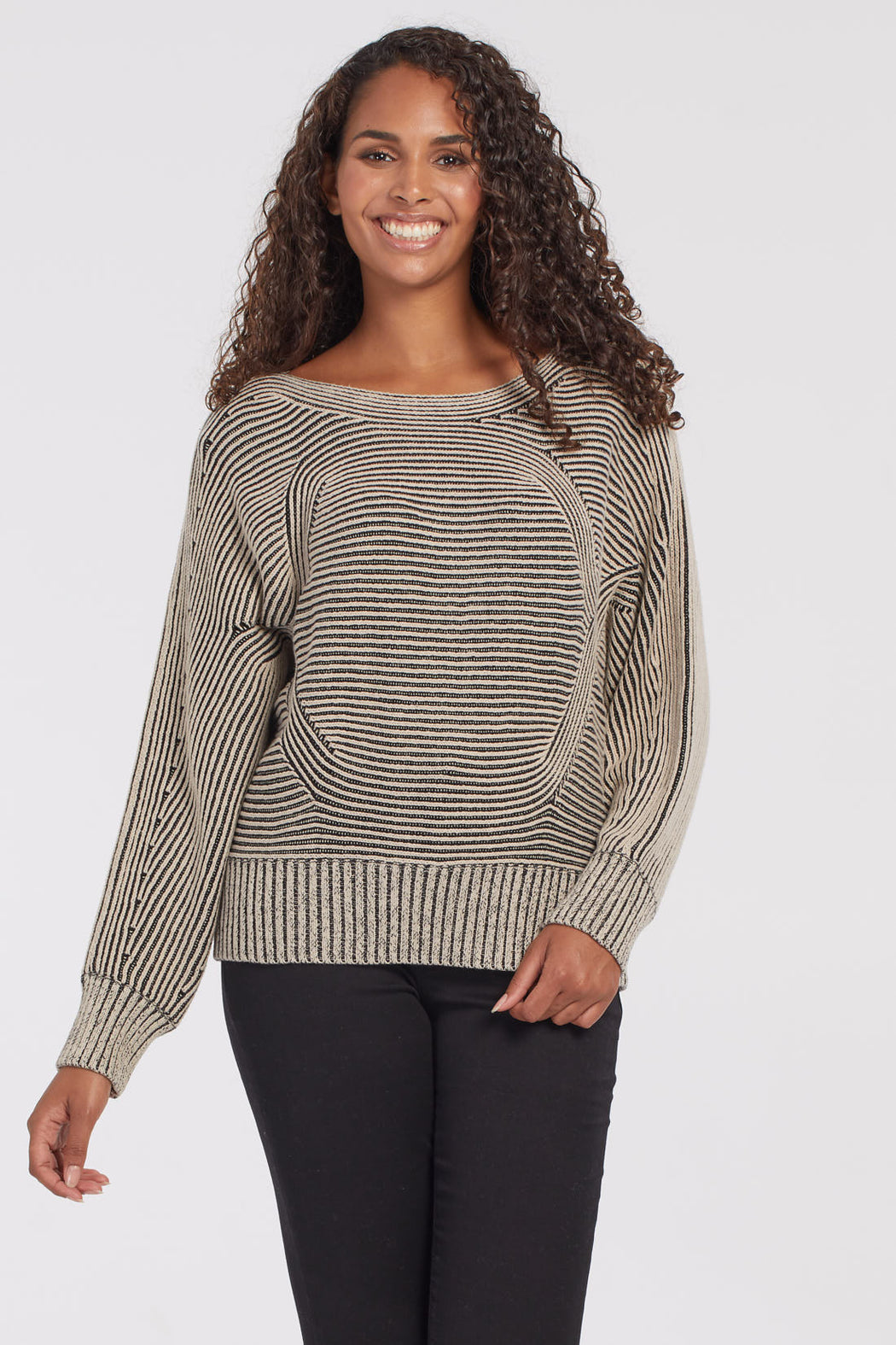 Tribal Long Sleeve Dolman Sweater. Designed with a mix of black and beige yarn for easy to pair neutrals, this dolman sleeve top is unlike anything else in your closet. Its ribbed fabric, captivating pattern, and double-colored knitting are right on trend.