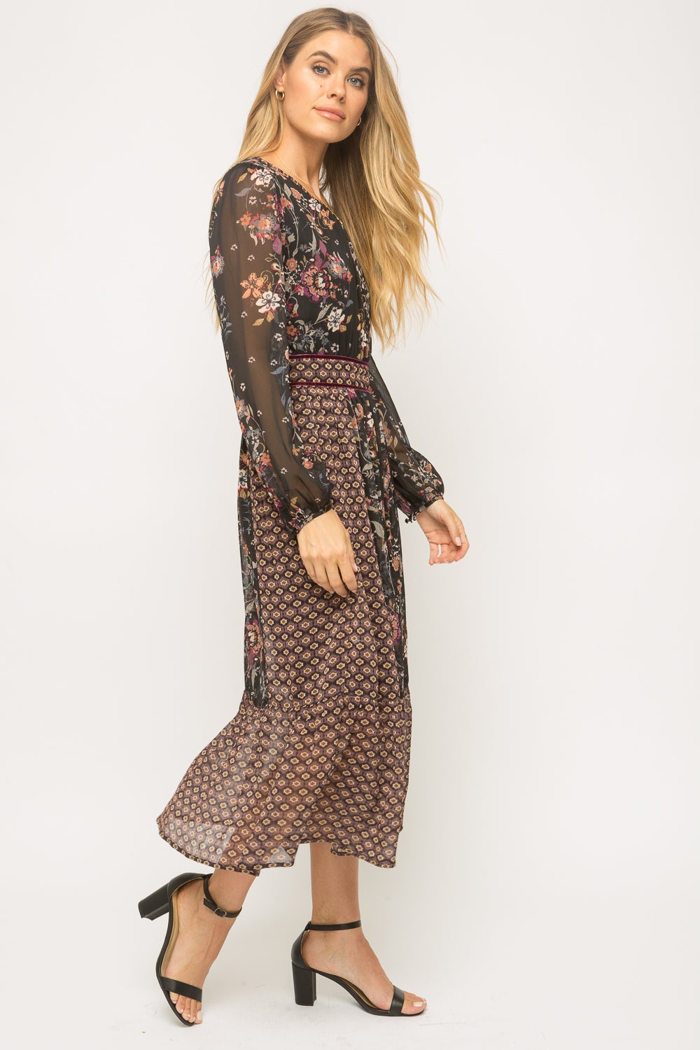 Mixed printed long sleeve dress  Effortless, pull on style Ruffled bottom hem Semi-Sheer long sleeves Pleating neckline and waist for added shape Fully lined -Self: 100% Polyester / Lining: 100% Polyester
