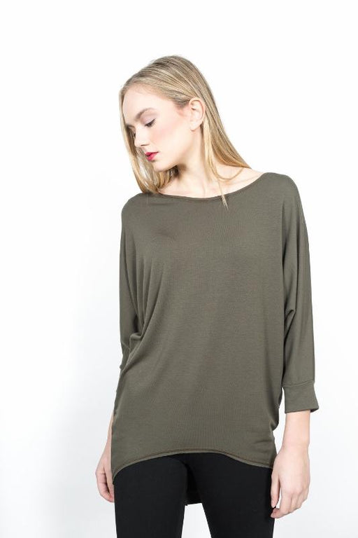 3/4 Sleeve Top.  French Terry-48% Rayon 48% Polyester , 4% Spandex  Machine wash cold, separately. Gentle cycle. Do not bleach. Lay flat to dry. Cool iron if needed.