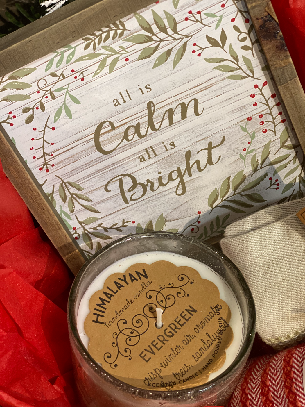 "....All is calm, all is bright... Send that nostalgic Christmas feeling to a special someone. This box contains two kitchen towels, and Evergreen candle, and a picture that whispers, ""All is Calm all is Bright""."