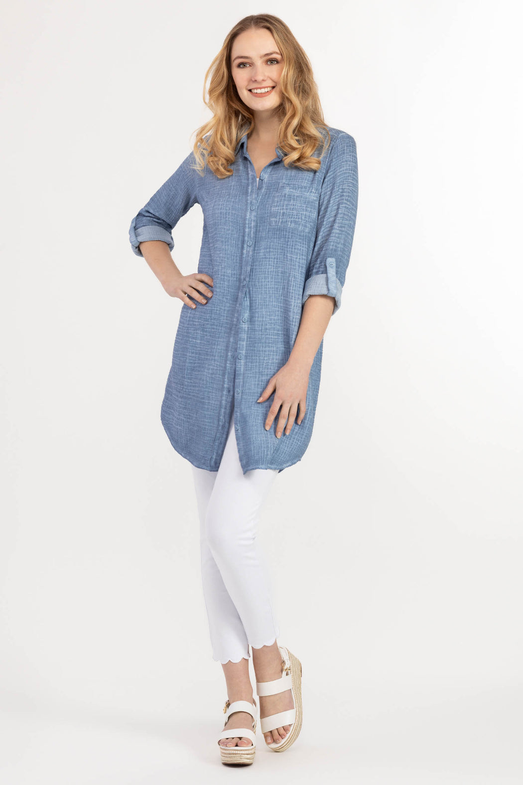 "No matter how you choose to wear it, you can't go wrong with our effortlessly chic menswear-inspired shirt dress. Try sporting this piece buttoned up with a belt at the waist for an ""urban fashionista"" vibe, or unbuttoned over a simple t-shirt and jeans for a more laid-back look.      100% Cotton     Adjustable sleeve     Crinkled gauze look     Pocket detail     Mid-thigh length     Machine wash delicate cycle cold water, line dry"