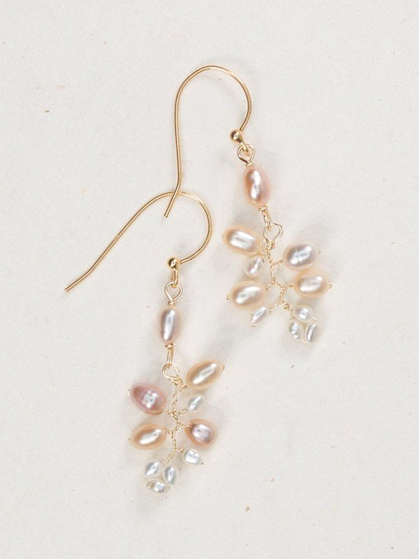 Become an instant island darling when you don our oh-so-feminine Corabelle Earrings. A precious cluster of seed pearls sway from wire hooks, elegantly capturing the gentle Aloha spirit.