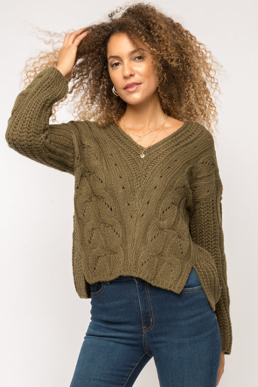 Mystree Cable knit pullover sweater      Effortless, pull on style     Wool blend warm fabrication     V-neckline     Side slits detail  -Available in 2 colors (Grey, Olive)  -55% Acrylic, 23% Wool, 22% Nylon