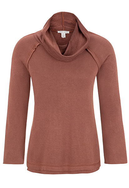 This season, look cute and be cozy in this relaxed fit cowl neck sweater. The wide cuffs add a layer of cultivated beauty to a classic fall look.
