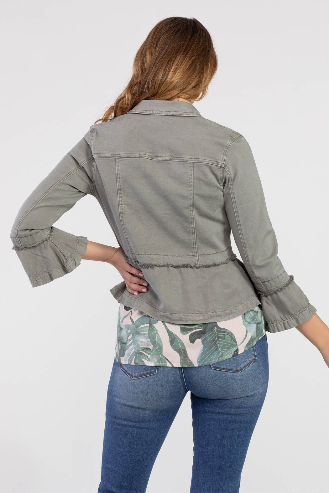 Think of this piece as the classic denim jacket's better half: same button front and classic collar but with a bell sleeve and a frayed detail at the waist and cuff. The body is made of stretch colored denim and the sleeve and bottom half are made using a soft tencel fabric. Wear it with blue jeans or patterned pants as the finishing touch on a fun casual outfit.