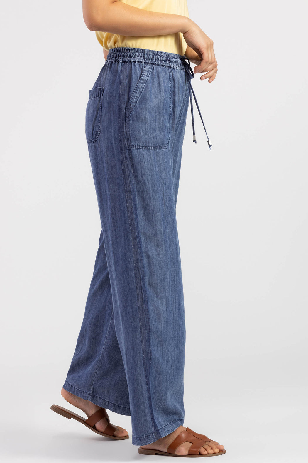 A darker-wash stripe running along each leg sets these flowy palazzo pants apart. Light as air with a drawstring waist, they're perfect for warm-weather days that call for loose and lightweight options.