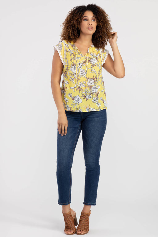 This super-cute blouse was made for clear skies and sunny days. With lace detailing at the shoulder, lace scalloping at the sleeves, and a yellow-and-white palette in a lightweight crêpe fabric, it's the perfect top for the warmest days.