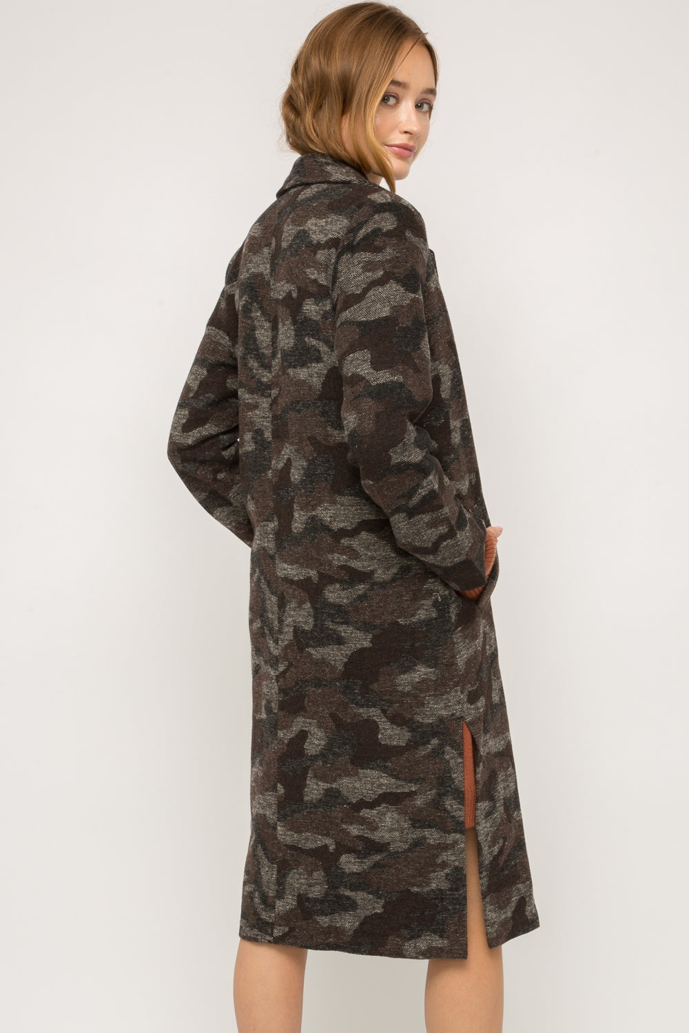 Mystree Camo Long Coat. Camo long coat Button-front closure Side pockets Side slits detail Fully lined -100% Polyester -Contrast: 100% Polyester -Lining: 100% Rayon  Edit alt text