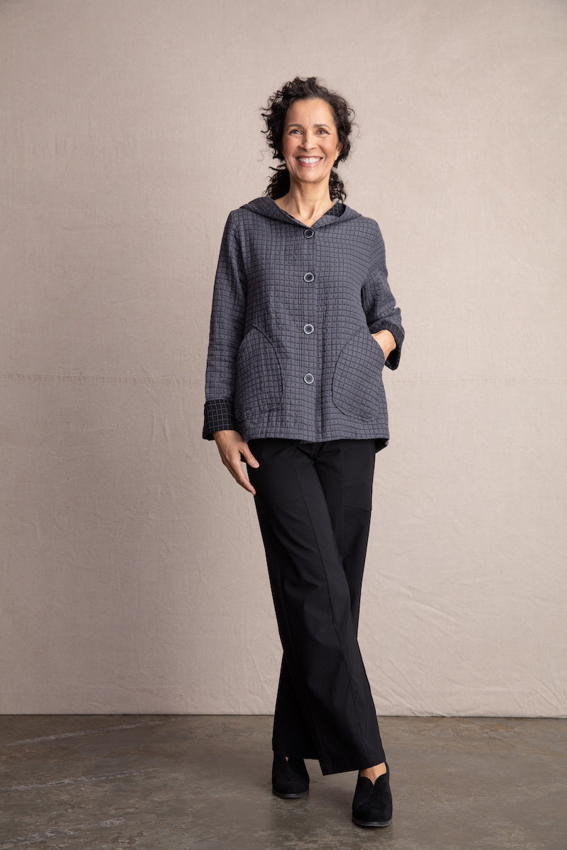 A chic top layer in a contemporary shape, the Hooded Button Jacket is part of Habitat's Double Face Windowpane collection. It buttons in front with angled front pockets, long sleeves with contrast cuffs, and a contrasting center seam in back. A versatile piece that works as a top and a jacket.  51% cotton, 45% polyester machine wash cold, tumble dry low