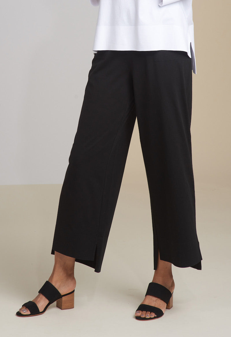 "An updated flood with attitude. Pull on wide leg pant with deep stepped slit hem. 2 on seam pockets. Soft elastic waistband sits at the natural waist. 26"" inseam.   • 100% cotton"