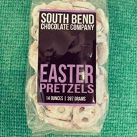 White Chocolate covered pretzels trimmed in an amaretto chocolate, from The South Bend Chocolate Company.