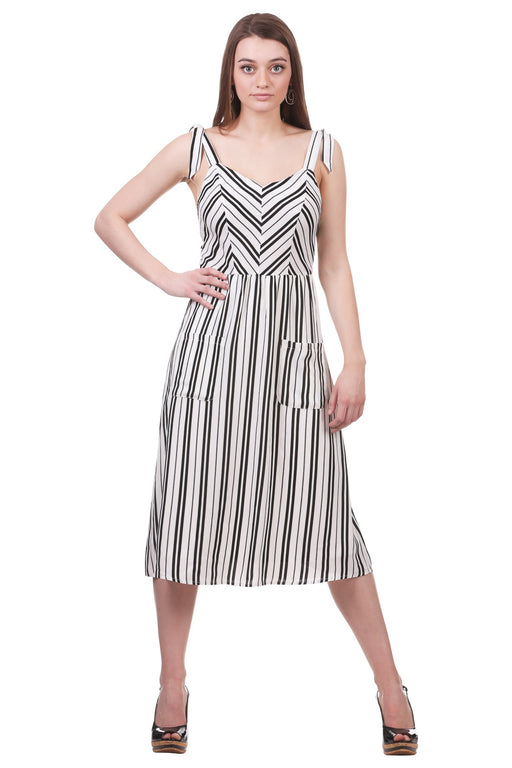 Be ready for whatever lies ahead with our Striped Midi Dress with Ties and Pockets. The slight V-neckline adds a sense of charm, while the ties on the shoulders paired with the pockets keep this dress flirty and fun.  Pair with heels and a clutch for the perfect date night out or with sandals for a day at the beach!