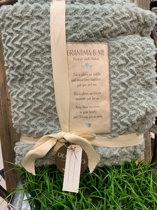 The Grandma and Me Cuddle Blanket is a great gift for Grandma and those awaiting Baby. The blanket's plush design with a personalized patch for Grandma invites a great way to snuggle and bond with Baby. It will turn a special moment into a sweet memory for Grandma.