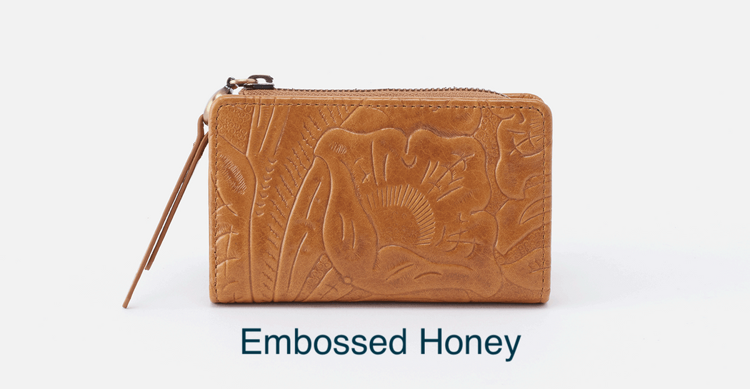 "nspired by a vintage tooled leather wallet, Dart is the perfect small leather wallet for days when you reach for a crossbody purse. Crafted in our signature vintage hide leather that only gets more beautiful over time with use and wear.  DETAILS Brushed Antique Brass hardware Top zip and snap closure Interior: Back wall and front wall both have 2 credit card slots, center zip compartment Wanderlust lining 4.25"" W x 3"" H x 0.75"" D"