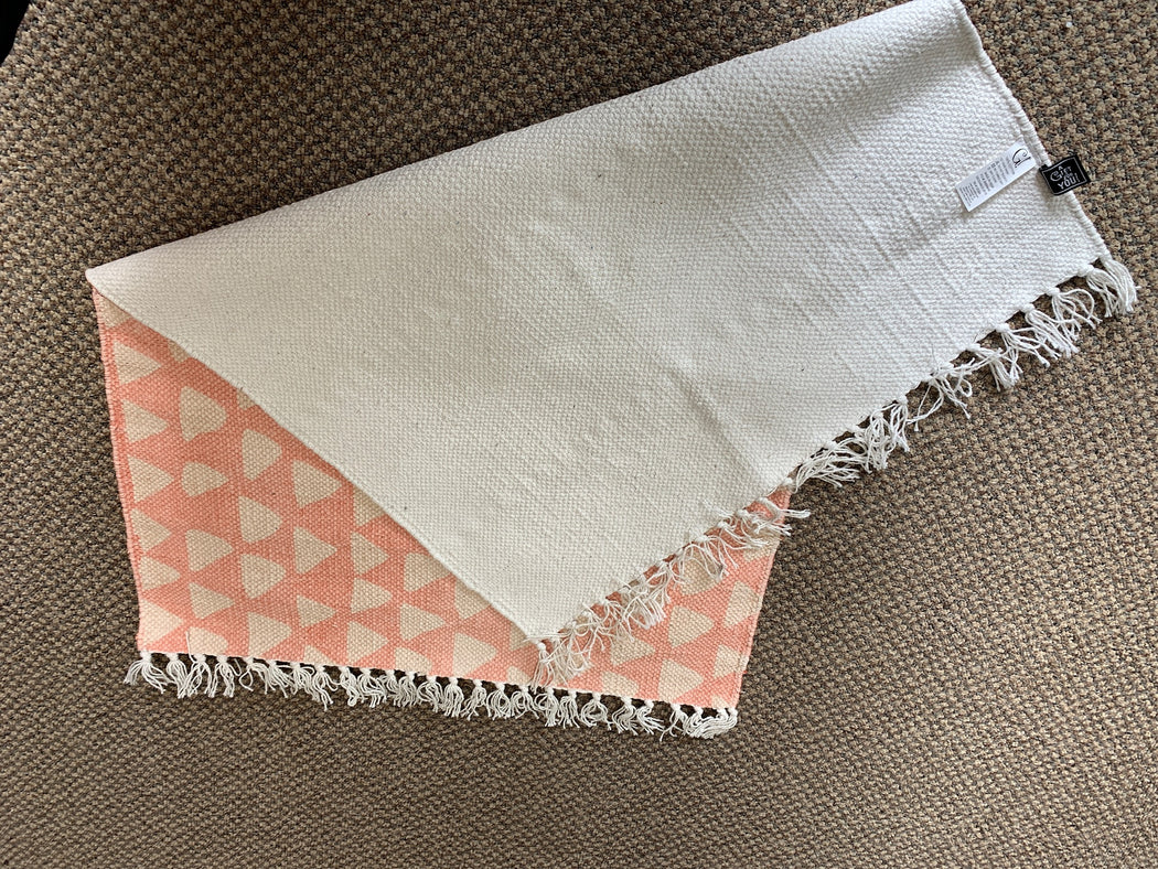 2 x 3 Pink rug with white triangles.  White Tasseled Ends