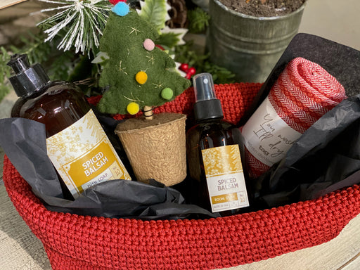 "This cute, red, crochet basket is perfect for getting your house ready for the season! It comes with dish soap and room spray with a Spiced Balsam scent. You will also receive a dishtowel and a 7 1/2"" felted tree."