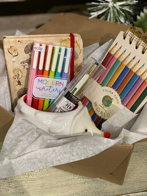 This is the ideal box for your favorite art lover! They will receive two sketchbooks - one decorated with colored pencils, and the other with hedgehogs and mushrooms. We will add in a set of colorful gel pens and a multi-tool pen that all fit perfectly in the ceramic hedgehog that is also included.