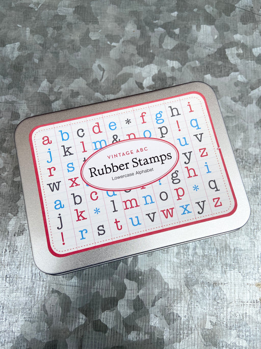 "Set of vintage, wooden, rubber stamps. Set includes 26 lowercase alphabet plus 4 punctuation stamps. Stamps are approximately 1/2"" square."