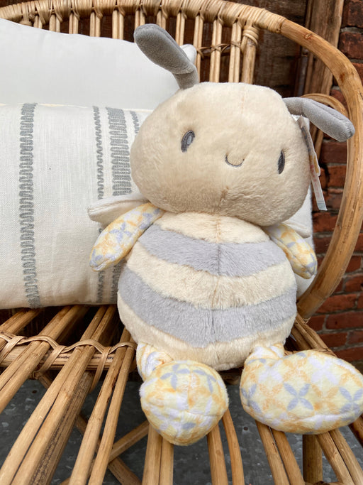 """Baby Bee Happy"" 12"" stuffed plush by Nat & Jules. This cute little gray and yellow guy is extra soft and squishy and made of 100% polyester."