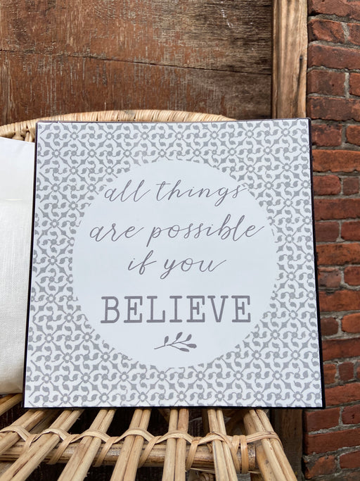 "Gray and White metal sign reads, ""all things are possible if you BELIEVE"". Hangers are attached to the back so it is ready to hang. Measures 12"" square."