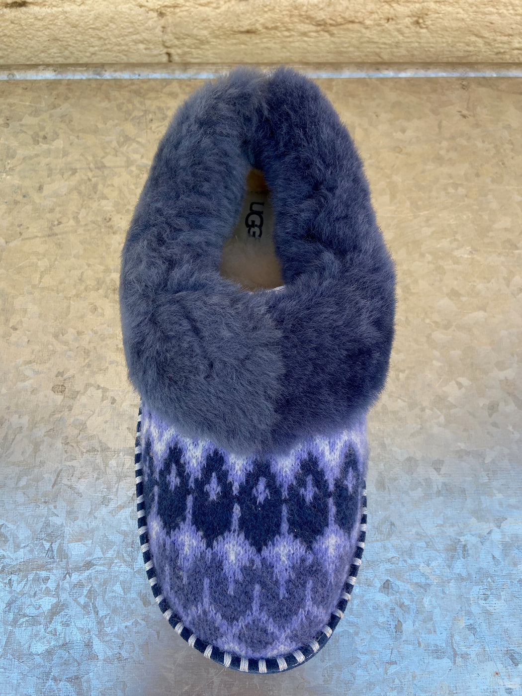 Navy 100% Textile Dyed Sheep, Fur Origin: Australia Rubber sole Fully lined with UGGpure wool Molded rubber outsole for indoor/outdoor use Knit upper