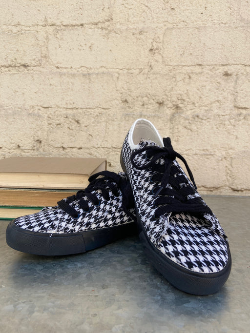 Lace up these Houndstooth sneakers, from Charlie Paige, finished with raw edges and black soles. Cotton, Rubber.
