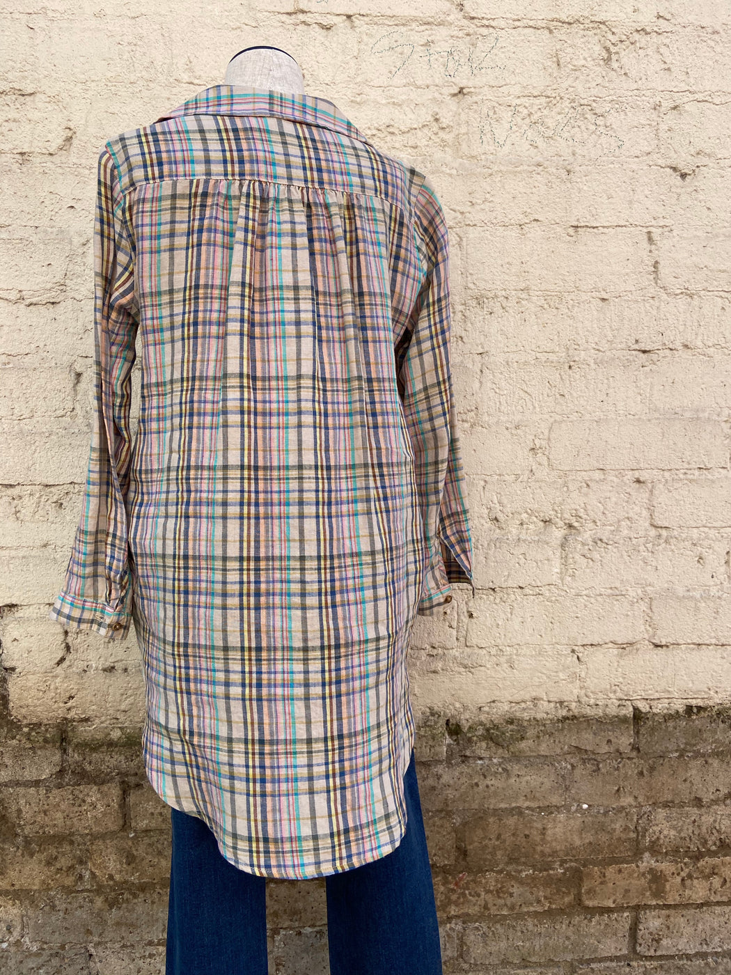 This pastel plaid tunic, by Uncle Frank, is 100% linen and is long sleeved with two pockets.
