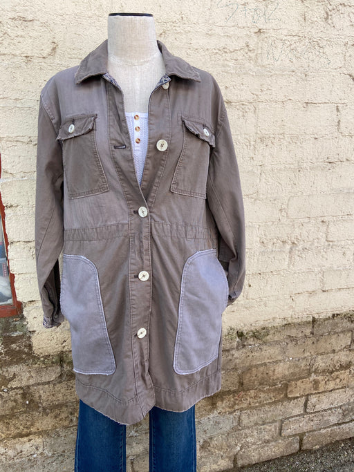 Cotton twill slouchy jacket pieced with contrast fabrics.  Button closures down the front Double bust pockets Hip pockets Raw trim Adjustable buckle in back for a customizable fit Machine wash cold