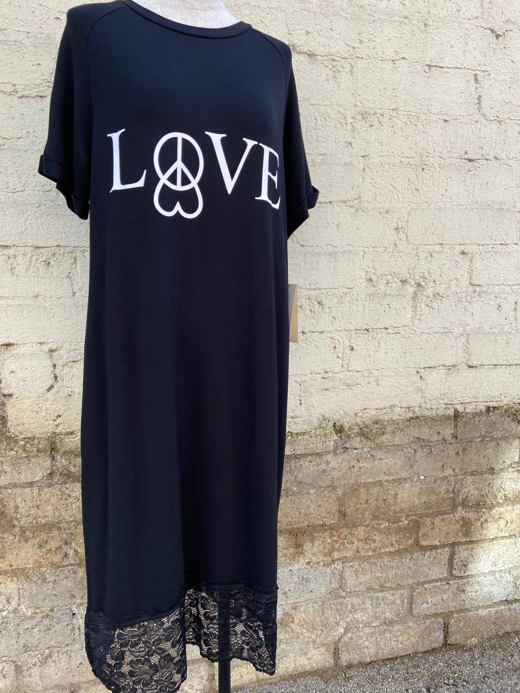 "Extremely comfortable, black, short sleeved nightgown. It has a lovely lace trim at the bottom, and a graphic that reads ""Love"" with a heart and peace sign."