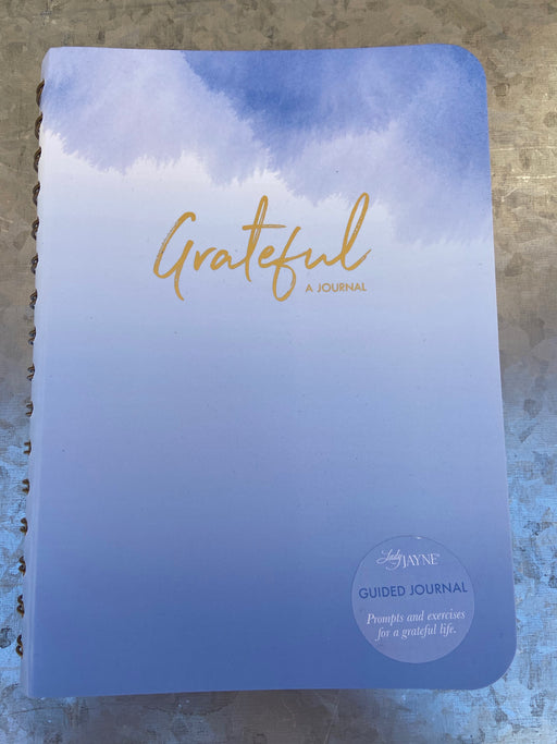 "This journal, by Lady Jane, is filled with prompts and exercises to encourage deeper introspection on how to live a more grateful and fulfilling life. Spiral Bound 8.5"" x 6.25"""