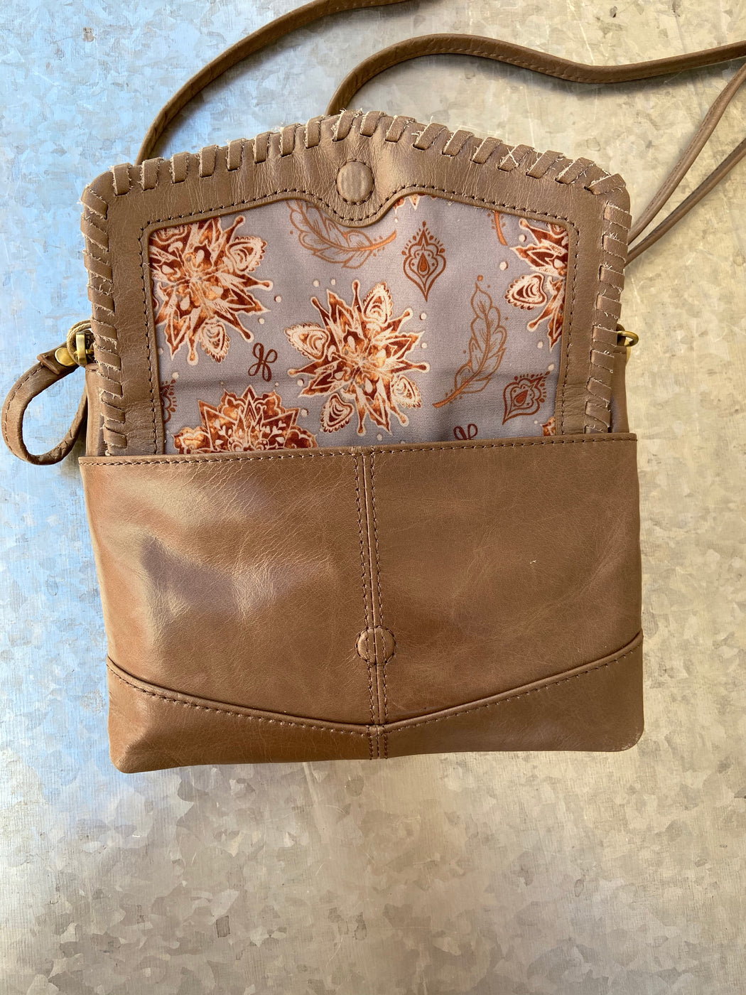 Two bags in one! The Stroll crossbody easily converts to your grab & go wristlet by simply removing the long crossbody strap. It's the perfect size for your phones, ID, cash, and credit cards. Crafted in our signature vintage hide leather that only gets more beautiful over time with use and wear.