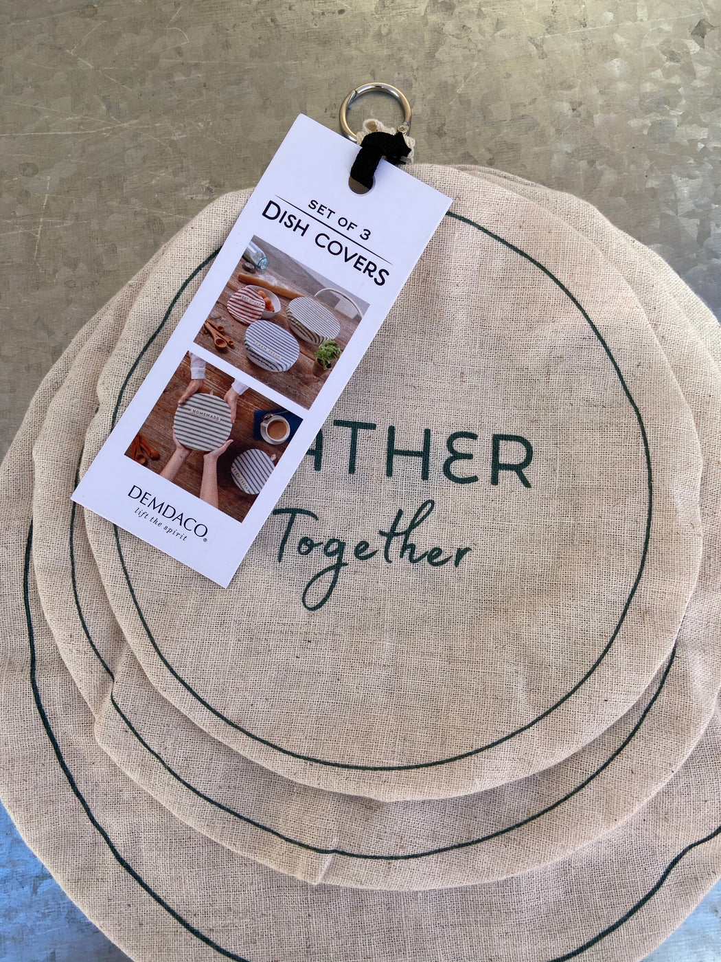 "Size: 10.5""H x10.5""W x0.25""D Materials: cotton, linen Care Instructions: Warm Iron as Needed, Wash With Similar Colors Only, Tumble Dry - Low, Machine Wash - Cold, Do Not Bleach, Machine Wash - Delicate Sentiment: Gather Together; Made To Share; Good Food"