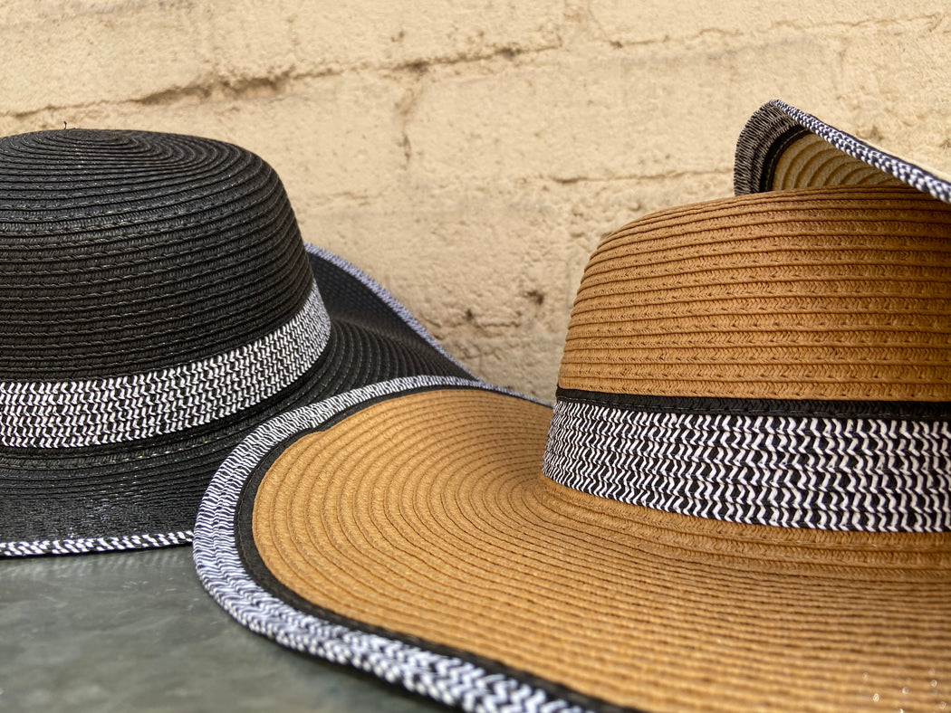 We have three different colors of this fun, sun hat with black and white trim. It comes in Ivory, Brown, and Black.