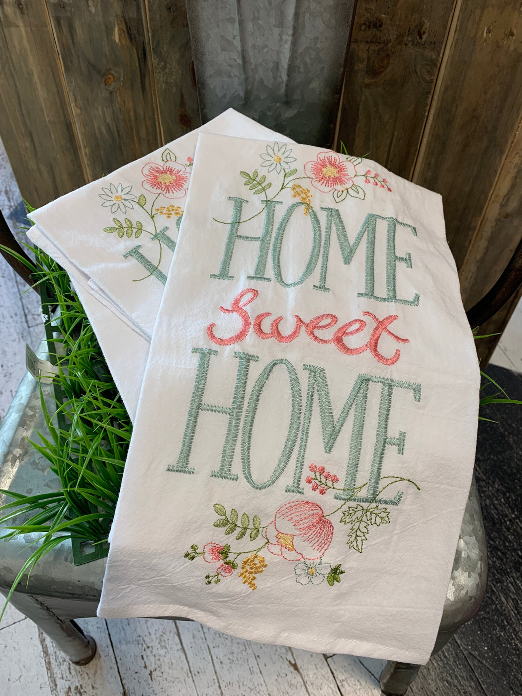 "This spring themed, embroidered towel reads, ""Home Sweet Home""."