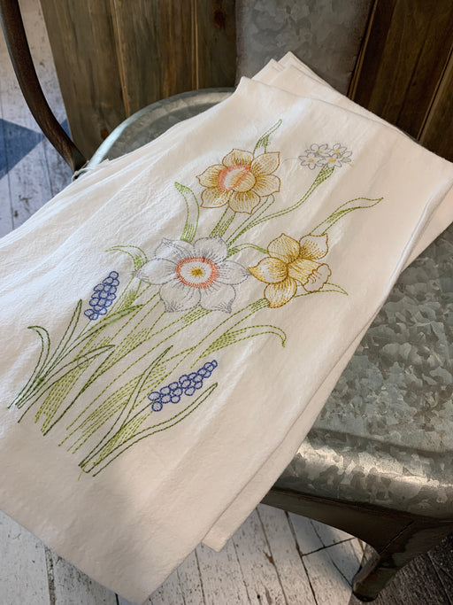 Beautifully embroidered daffodil tea towel.