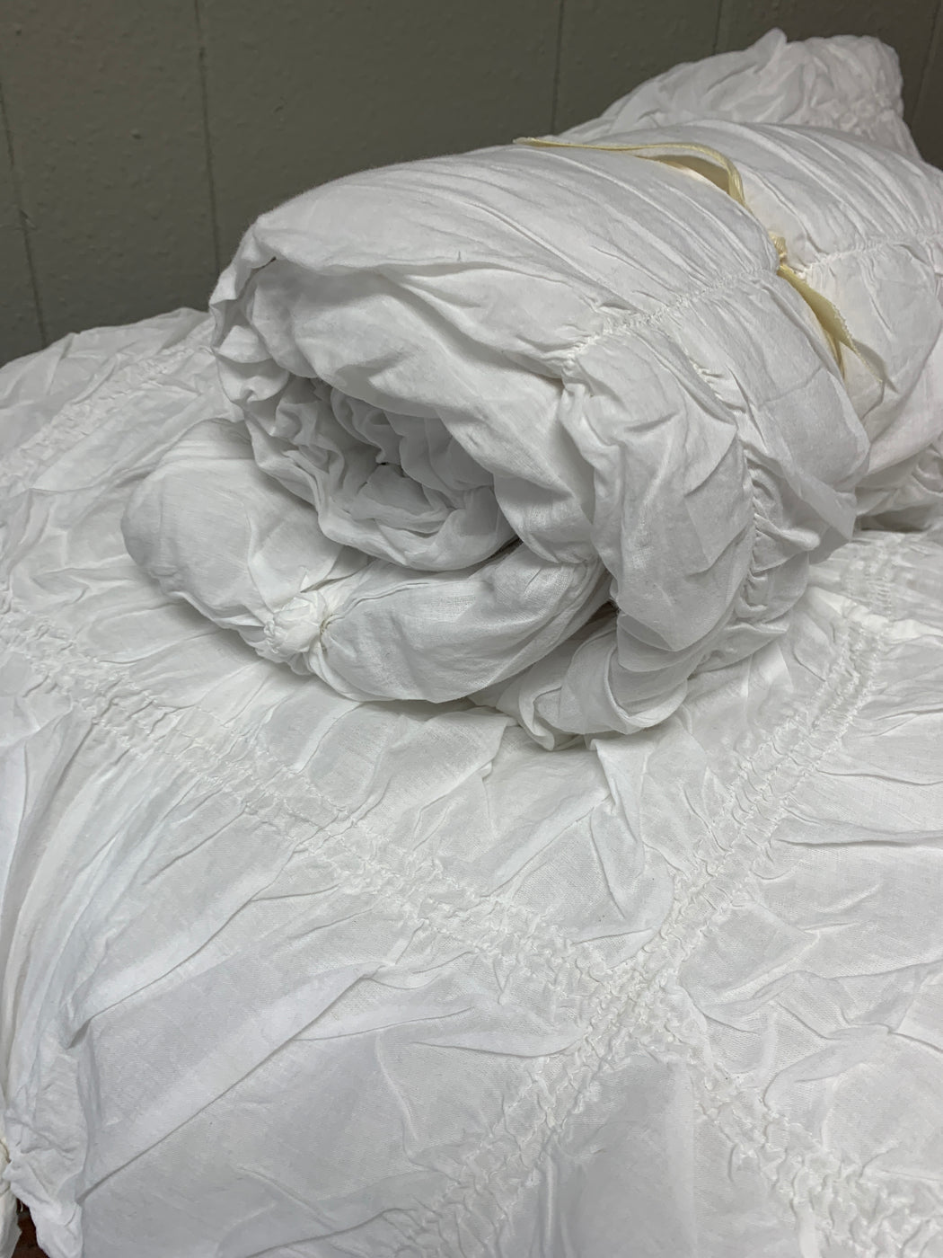 White, Queen comforter with two standard shams.