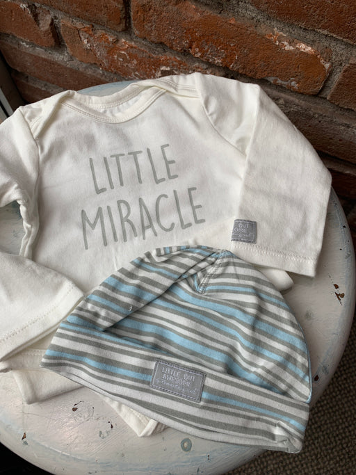 Keep your little one fashionable and warm with this apparel set Made of close-knit cotton blend designed to hold shape Features convenient snap closure for easy diaper changing Machine wash cold inside-out with like colors on gentle cycle; tumble dry low