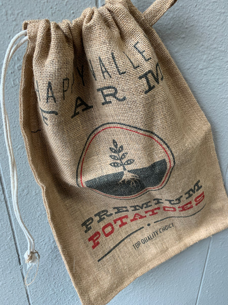 Burlap 100-percent burlap Removable cotton lining Cinch closure at top of bag Side tab for convenient storage Machine washable lining
