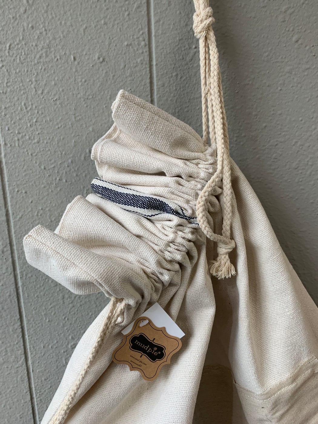 "Grainsack laundry bag features applied front canvas patch with frayed edges and ""Laundry"" printed sentiments and canvas rope drawstring.  Size: 30"" x 22"""