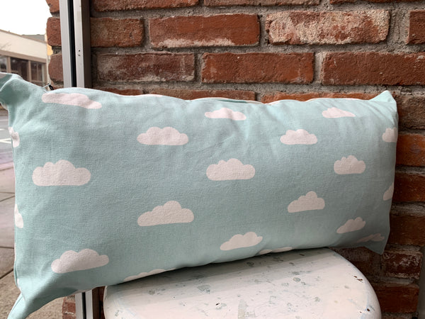This cloud print cushion in sky blue makes a charming addition to any room. Size: 60cm x 30cm. Material: Cotton.